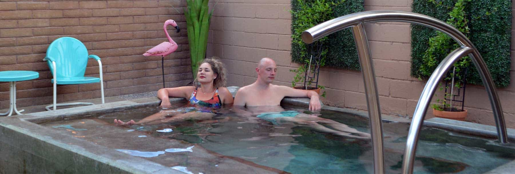 couple soaking at blackstone hotsprings in torc